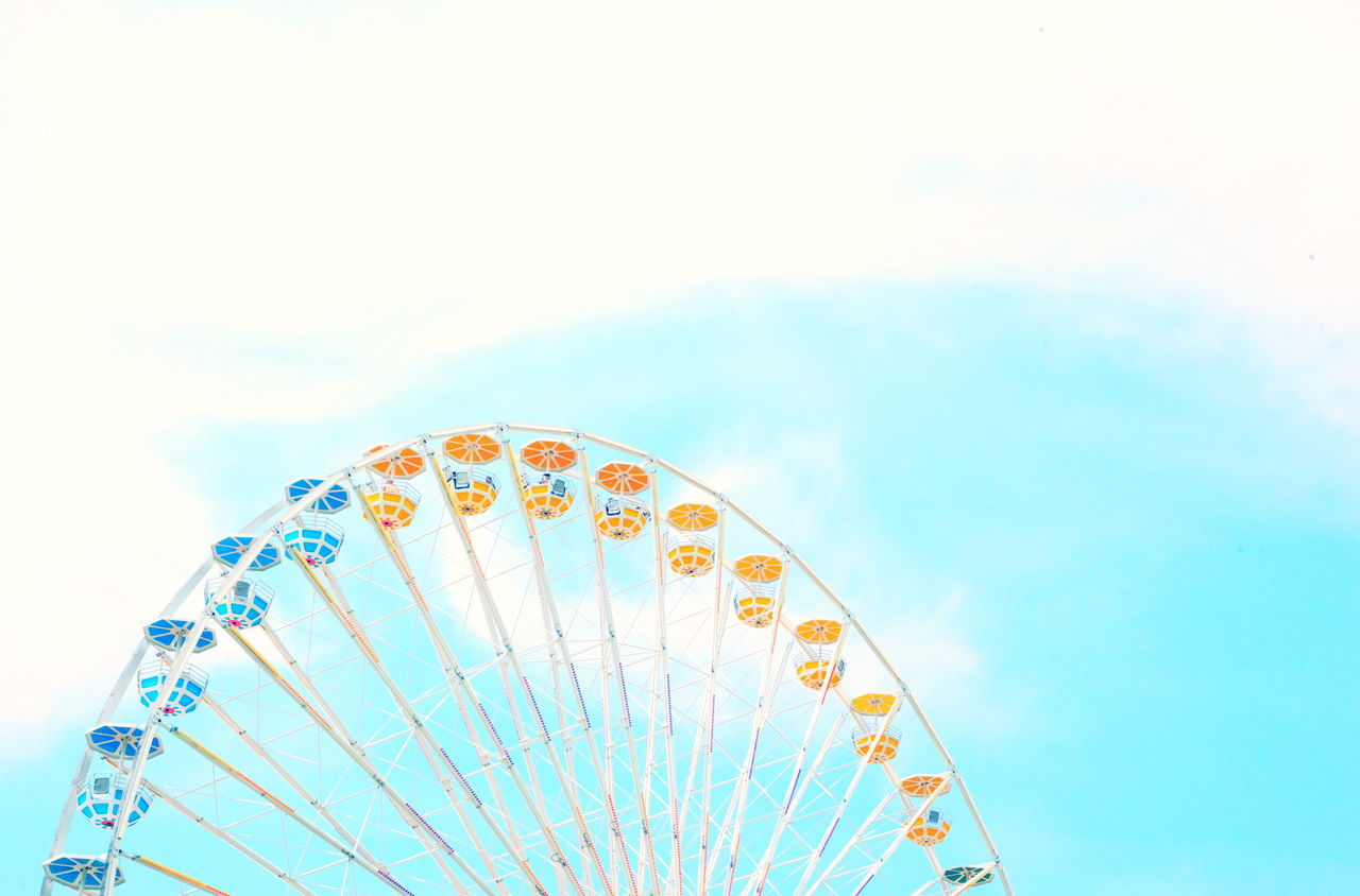 Amusement Park Amusement Park Ride Arts Culture And Entertainment Big Wheel Blue Carefree Day Ferris Wheel Fun Leisure Activity Low Angle View No People Outdoors Pastel Sky Yellow