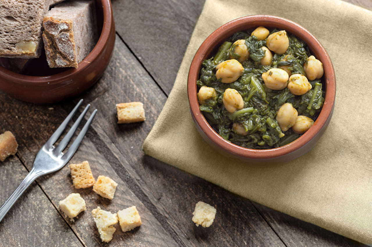Chickpea stew with spinach. Traditional Spanish recipe. Bread Chickpeas Cooked Cuisine Delicuous Dish Food Healthy Eating Meal Mediterranean  Mediterranean Food Plate Potaje Restaurant Rustic Spaın Spinach Stew Table Tapas Traditional Typical Vegetable Wood Wooden