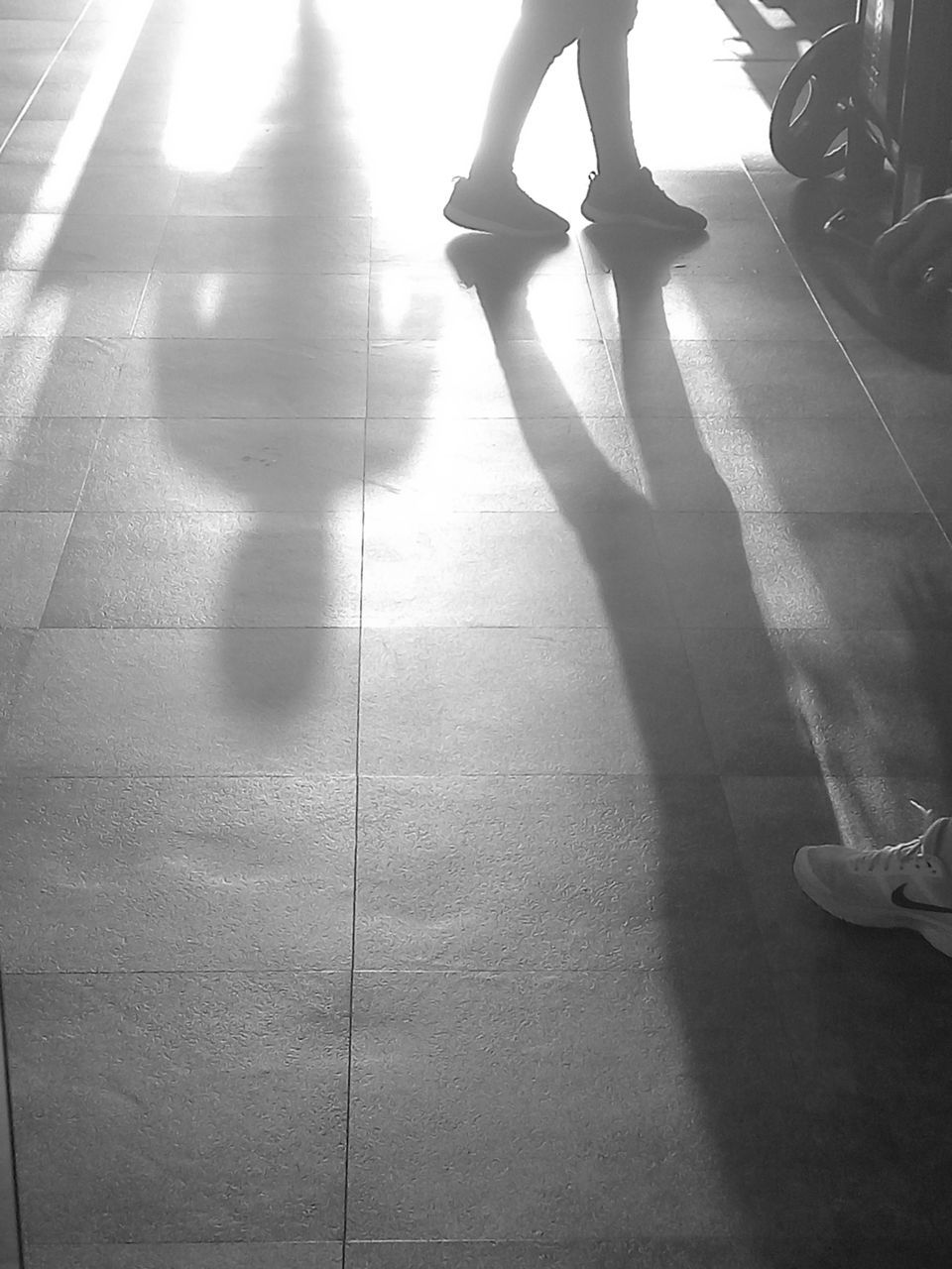 real people, low section, shadow, one person, sunlight, human leg, lifestyles, indoors, women, day, leisure activity, standing, human body part, people, adult