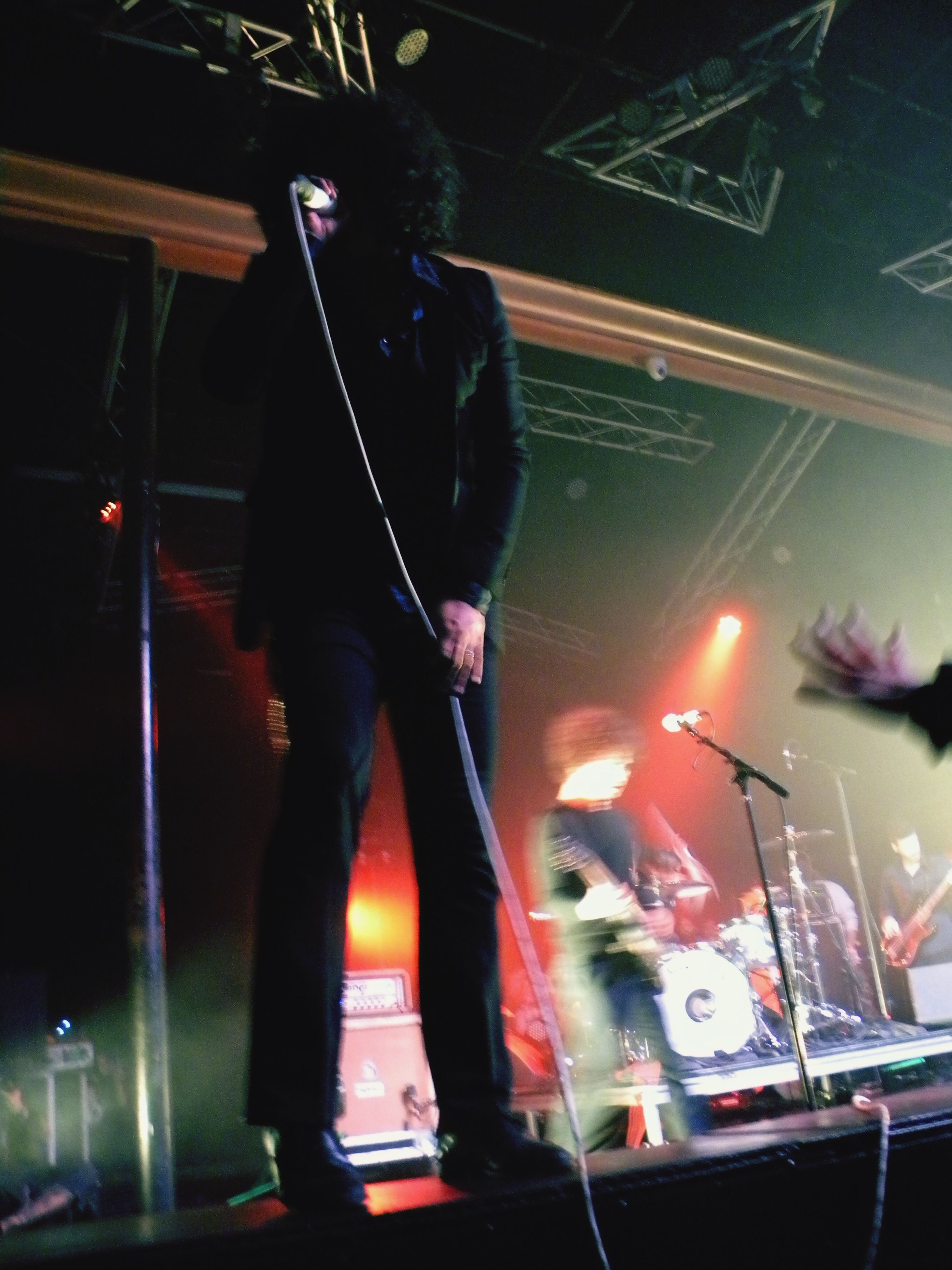 lifestyles, indoors, men, leisure activity, night, illuminated, standing, arts culture and entertainment, person, music, performance, nightlife, casual clothing, full length, skill, holding, three quarter length, blurred motion