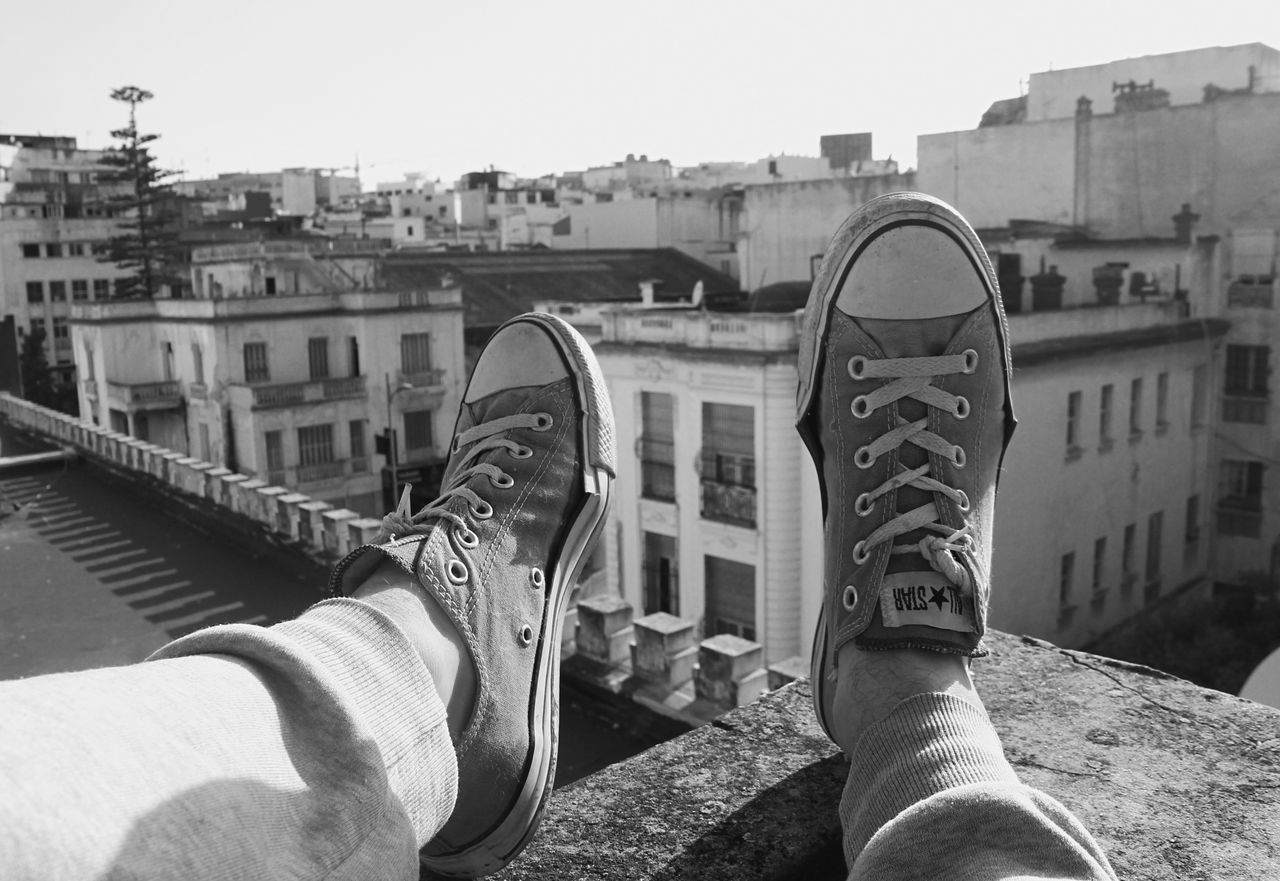 sneakers all star in black and white All Star Architecture Black And White Blackandwhite Building Exterior Built Structure Clear Sky Close-up Day Human Body Part Human Leg One Person Out Of The Box Outdoors Personal Perspective Shoe Sneakers