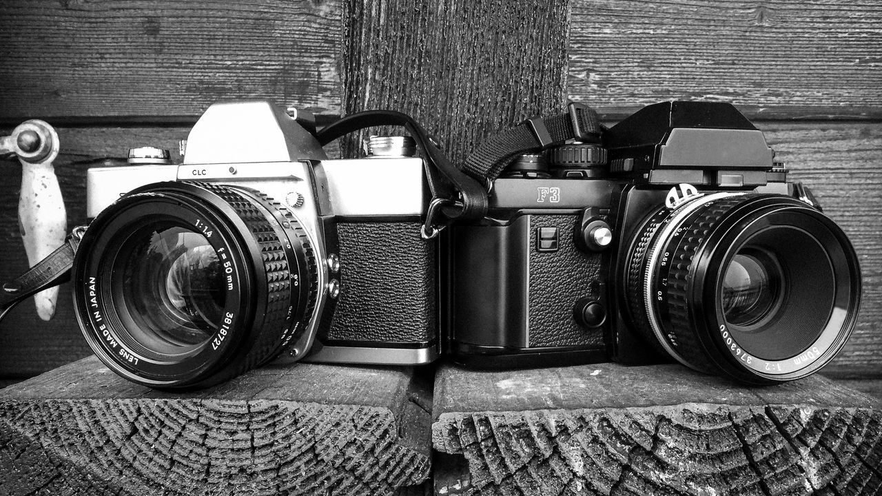 A film camera standing on a bench outside to remember that film photography isn't dead. Any photographers should at least try to shoot film once... Antique Art Camera Camera Camera - Photographic Equipment Camera - Photographic Equipment Camera Work Cameras Close-up Day Gear Lens - Optical Instrument Old Old-fashioned Outdoors Photographer Photographic Equipment Photographing Photography Themes Retro Styled SLR Camera Taking Photos Technology Tools Vintage