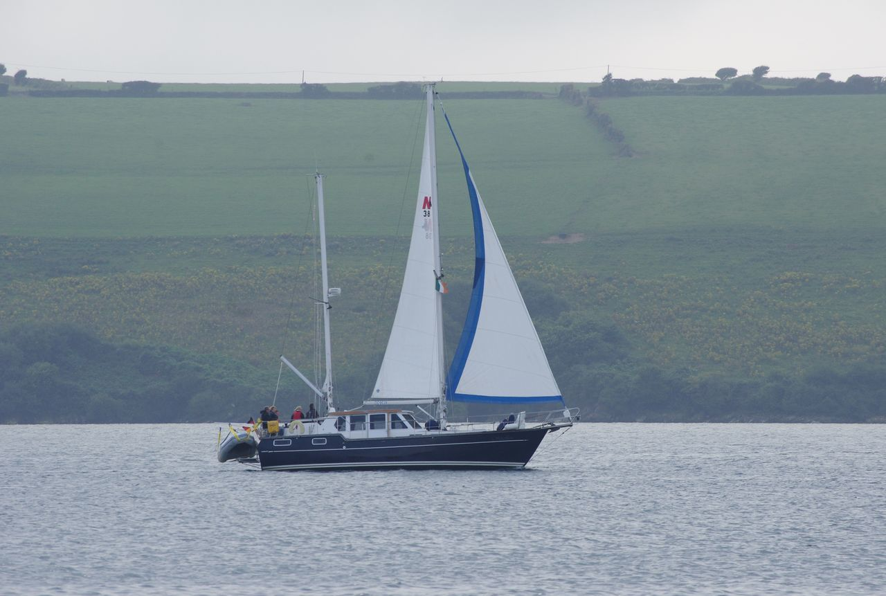 Blue Sails Boat Cloudy Day Sailing The Seas Coming Into The Bay Harbour Day Out Green Hills Ireland South Ireland Green Fields Irish Countryside Glandore Glandore, Ireland