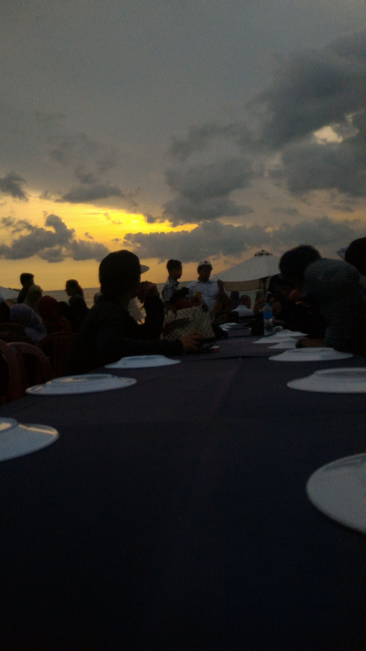 dinner on the beachSunset Sky Cloud - Sky Dusk Dramatic Sky Outdoors Scenics Nature Beauty In Nature Night Astronomy People Dinner Dinner In The Beach Beach On Sunset Leisure Activity Sea Beauty Catch The Moment Weekend Activities Roadtrip Bali Lifestyles Holiday Trip Paint The Town Yellow