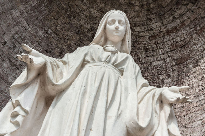 Close-up of Our Lady with open arms, bottom view. Catholic Christian Christianity Church Faith God Jesus Lady Maria Mary Mother Pray Statue Art Bible Conception Holy Immaculate Our Prayer Religion Religious  Sculpture Virgin  White