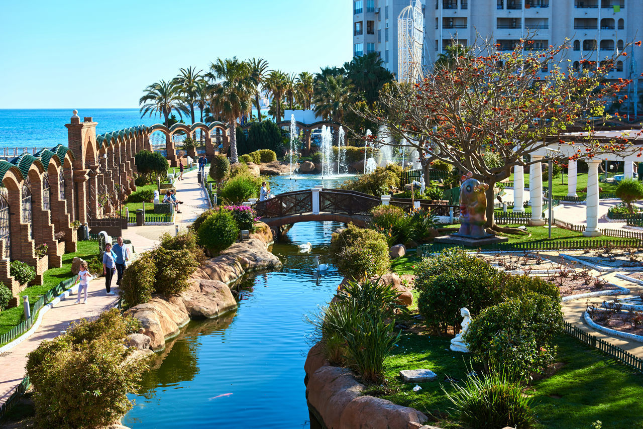 Oropesa del Mar, Spain- March 29, 2016: Picturesque Marina d'Or garden in the Oropesa del Mar resort town. Spain Architecture Editorial  Fountain Garden Landscape Landscaped Lush Foliage Marina D'or Mediterranean Sea Nature Oropesa Oropesa Del Mar Outdoors Palm Trees Park People Pond Scenery Seaside SPAIN Splashing Water Tourist Resort Town Travel Destinations Water