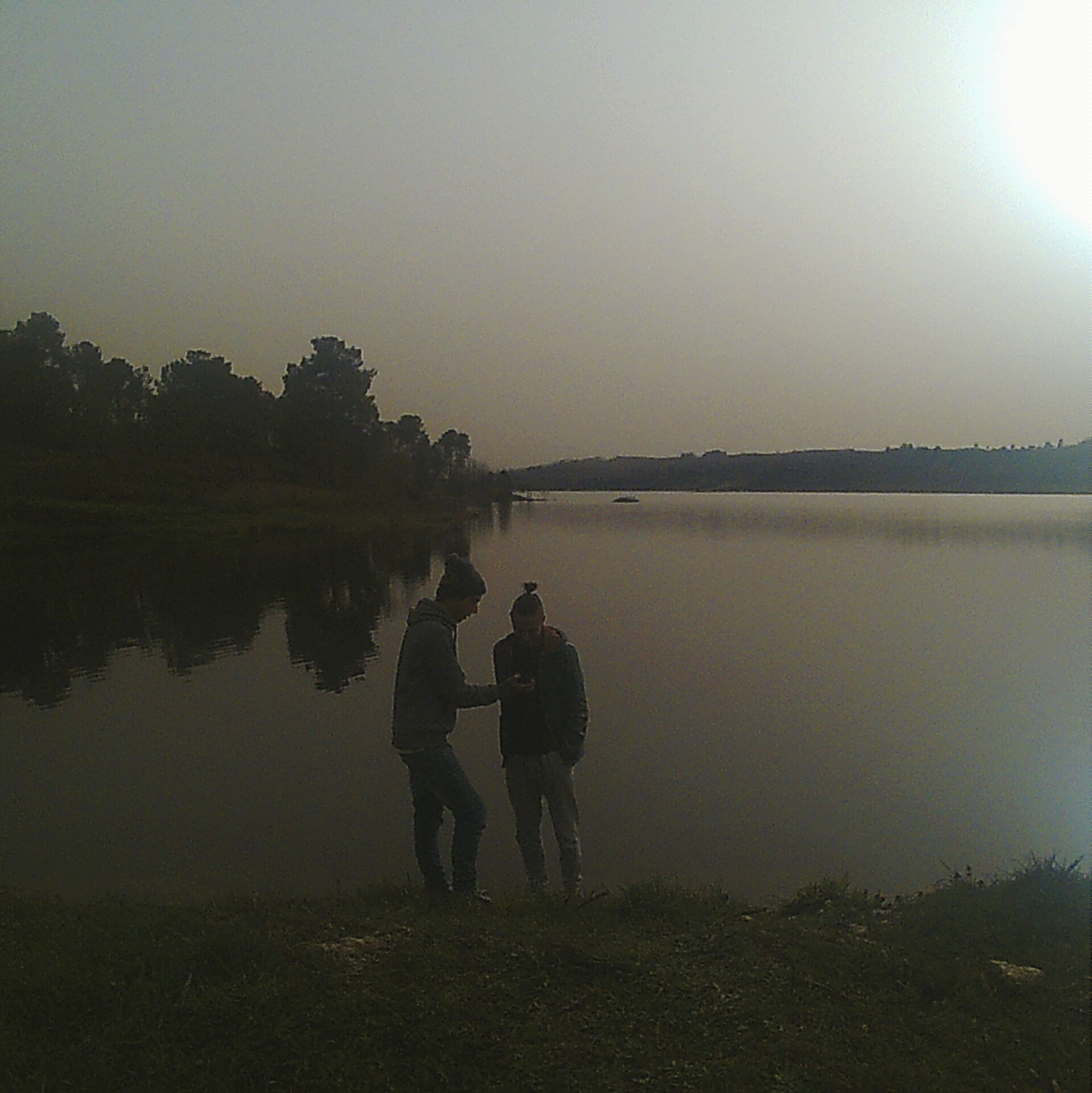 lifestyles, water, rear view, leisure activity, full length, men, standing, clear sky, lake, togetherness, tranquility, reflection, boys, tranquil scene, nature, casual clothing, bonding