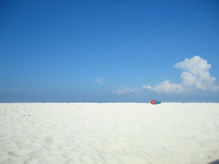Island in the sun.. with a Beach Blue Sea Sand Sky Outdoors Day Water Nature Summer Travel Destinations Tranquil Scene Vacations Beauty In Nature Landscape One Person beach umbrella! Adults Only Only Men People Adult Island In The Sun Ocean EyeEm Best Shots Philippines White Sand Beach