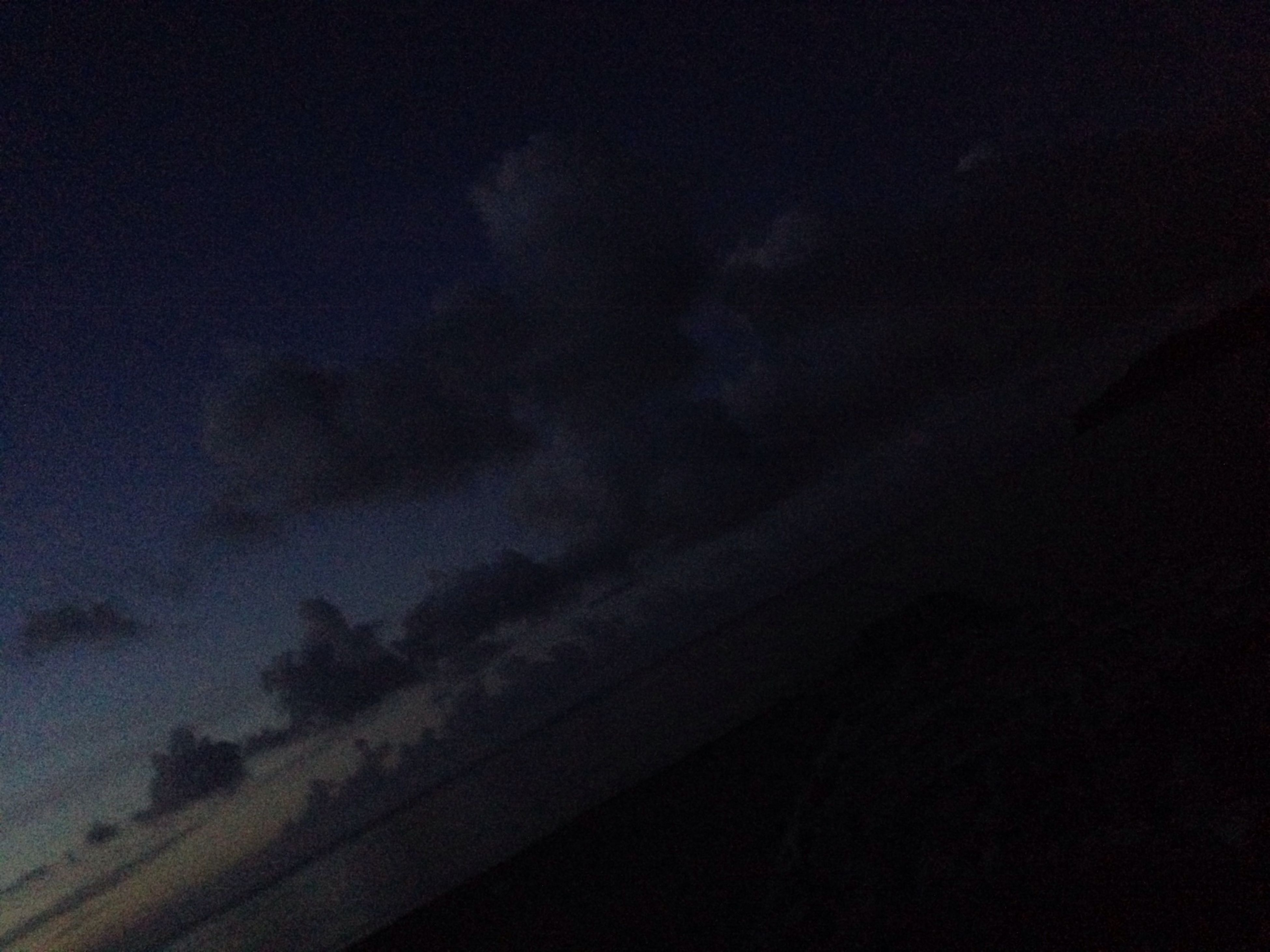 sky, low angle view, night, cloud - sky, beauty in nature, scenics, dark, tranquility, nature, silhouette, cloudy, tranquil scene, weather, dusk, overcast, cloudscape, copy space, idyllic, outdoors, no people