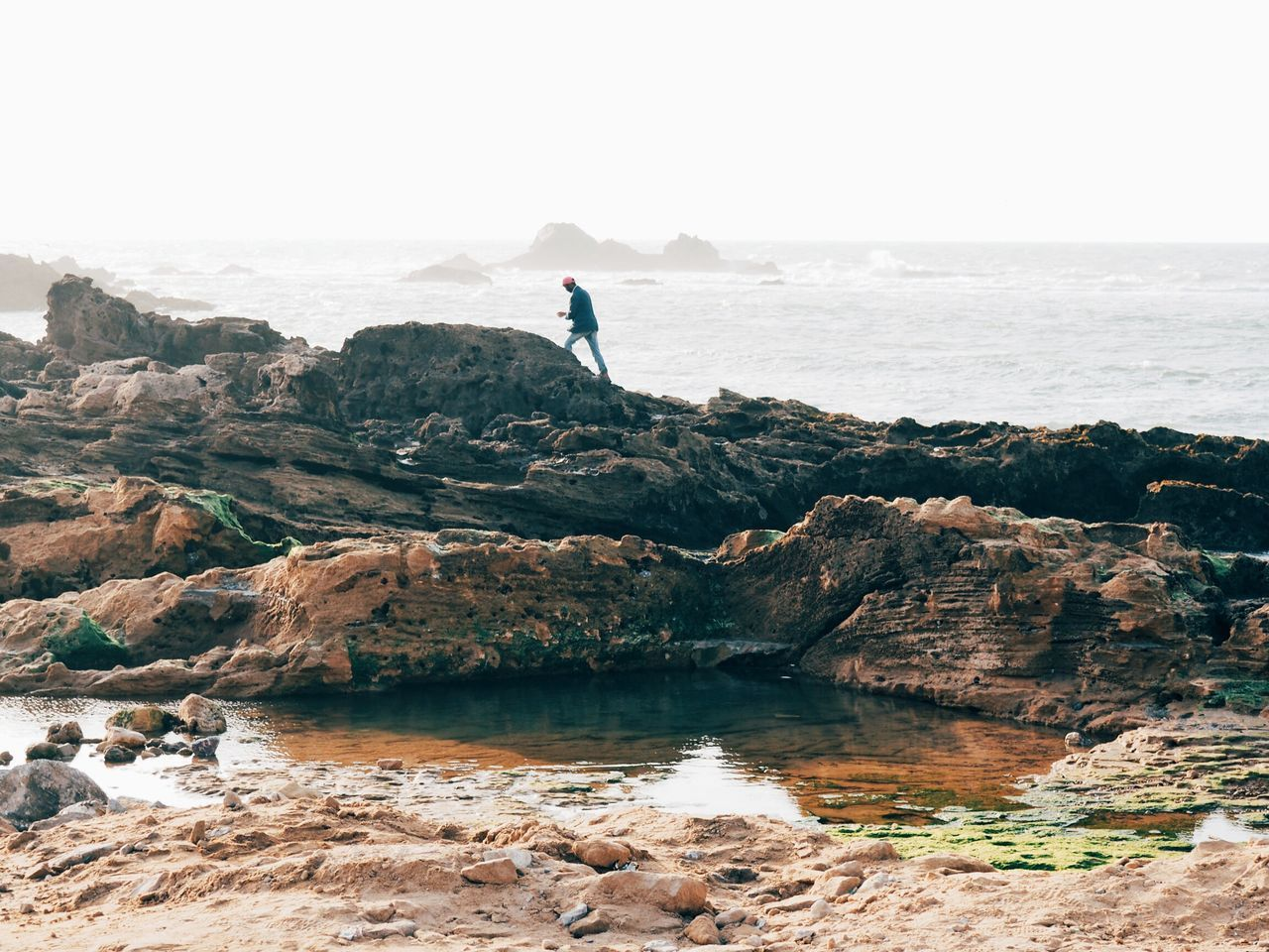 Sea One Person Beach Walk Rock Climbing Beach One Woman Only Silhouette Outdoors Leisure Activity Adult Water Morocco Morocco 🇲🇦 Tranquility Beauty In Nature One Man Only Wave Vacations People Nature Day Adults Only Beauty In Nature Only Women Sky