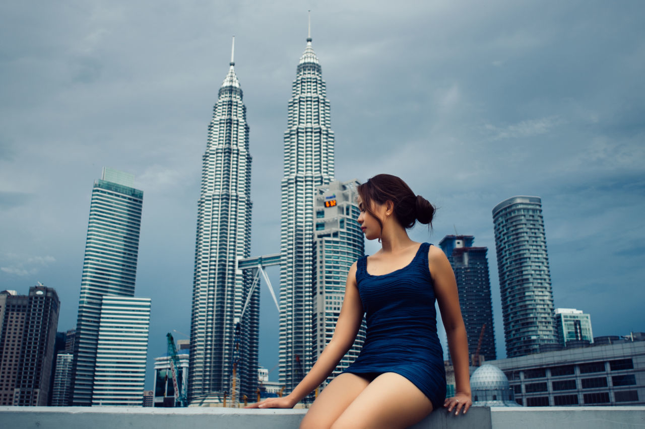 Adult Adults Only Architecture Beautiful Woman City Cityscape Cloud - Sky Day Downtown District One Person One Woman Only One Young Woman Only Only Women Outdoors People Petronas Twin Towers Sky Skyscraper Urban Skyline Women Young Adult Young Women