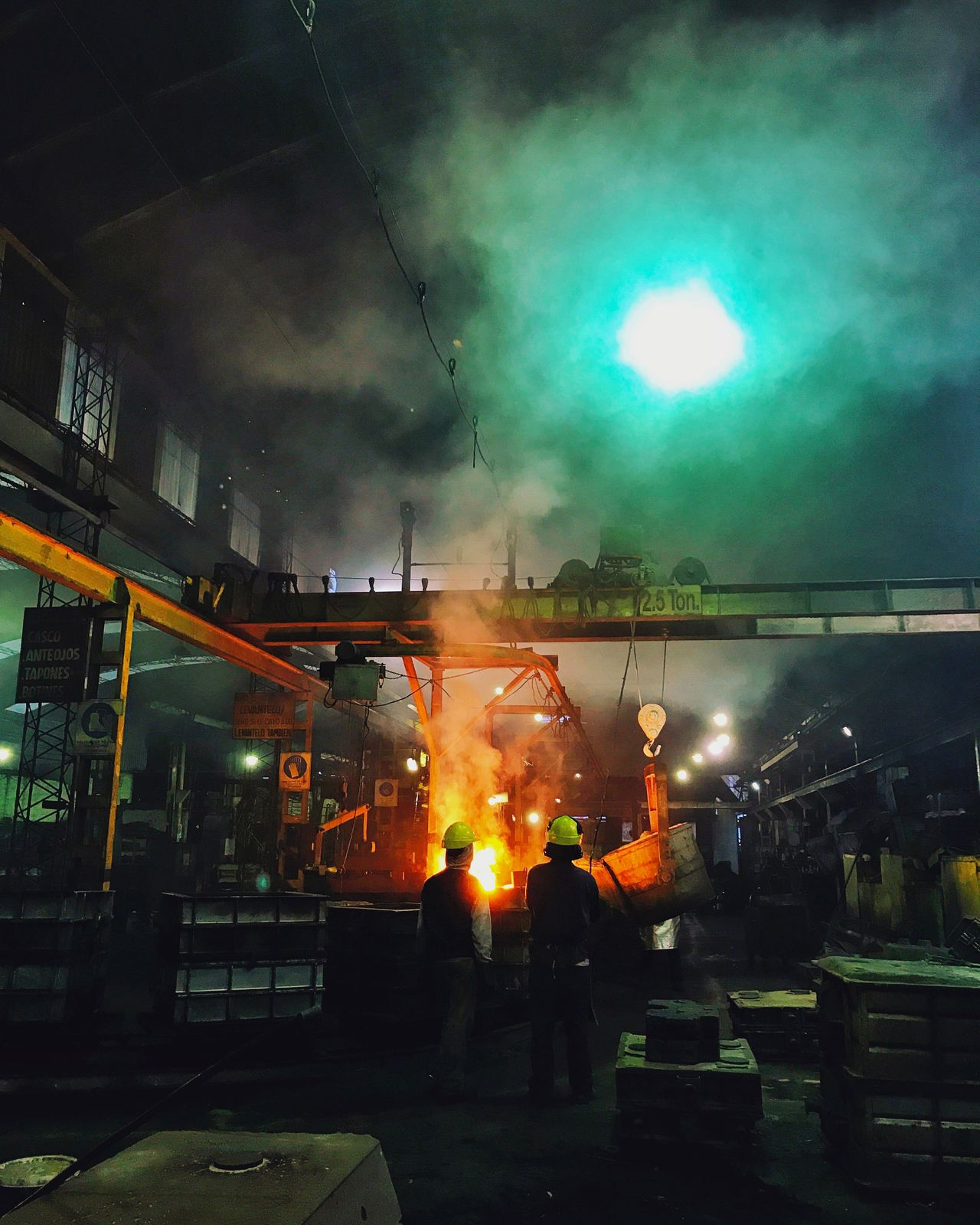 Night Real People Illuminated Smoke - Physical Structure Burning Heat - Temperature Men Occupation Built Structure Protective Workwear Building Exterior Flame Architecture Outdoors One Person City Metal Industry Sky People Factory Factory Photo