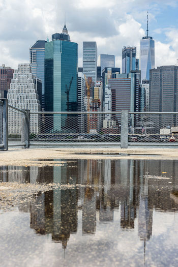 Manhattan New York City Reflection USA Architecture Building Exterior Built Structure City Cityscape Cloud - Sky Day Modern No People Outdoors Reflection Sky Skyscraper Tower Water Waterfront