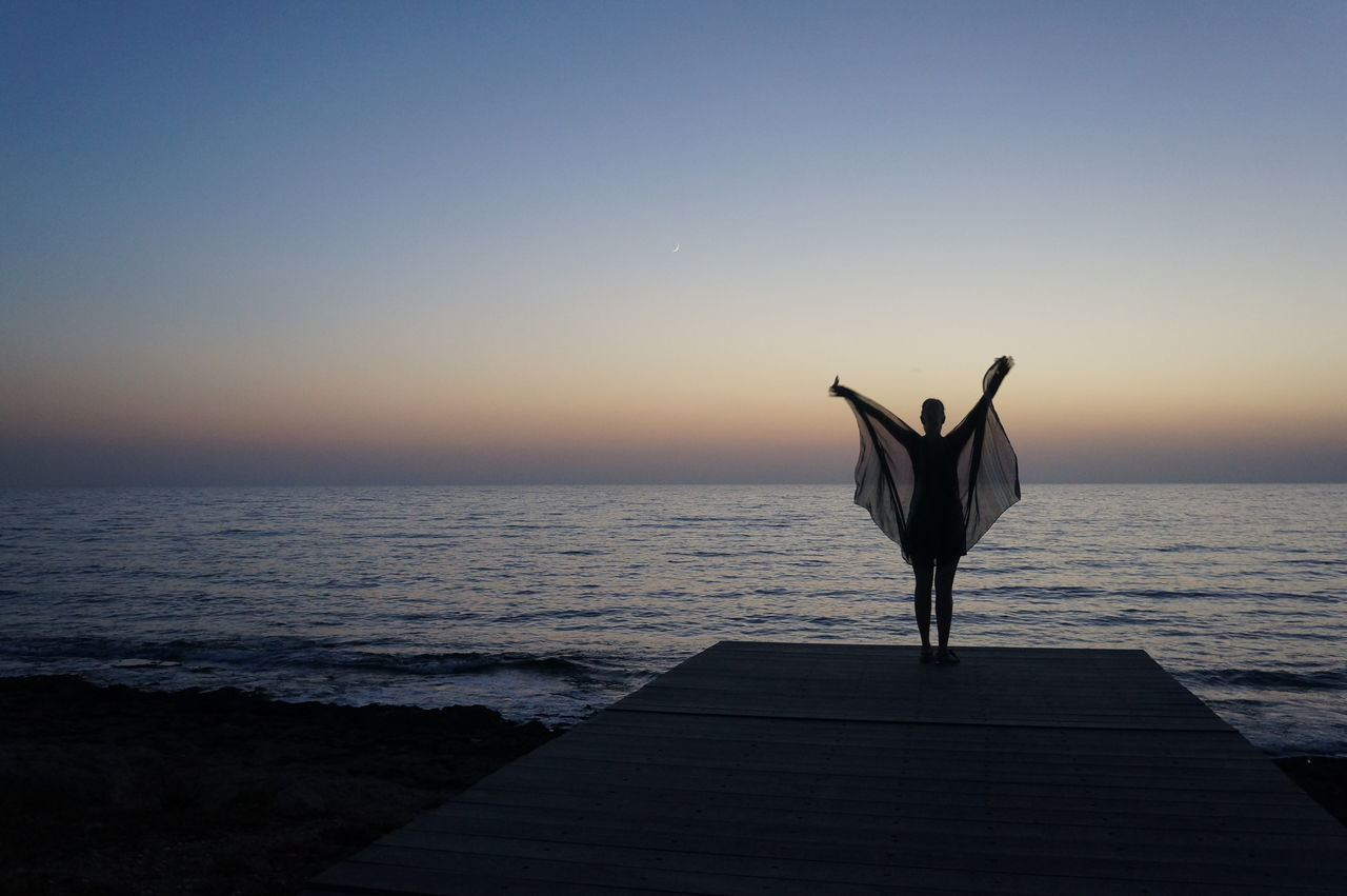 After Sunset Blue Hour Butterfly Clear Sky Girl Horizon Over Water Idyllic Mediterranean Sea One Person One Woman Only Outdoors Scenics Silhouette Vacations Water
