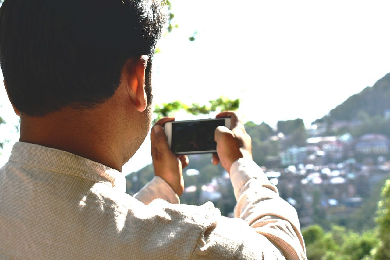 Photography Themes Photographing Wireless Technology Photo Messaging Portable Information Device Communication Technology Smart Phone Mobile Phone Only Men Mid Adult One Person Camera - Photographic Equipment Holding Headshot Adult Man Taking Picture Mountain View Trees