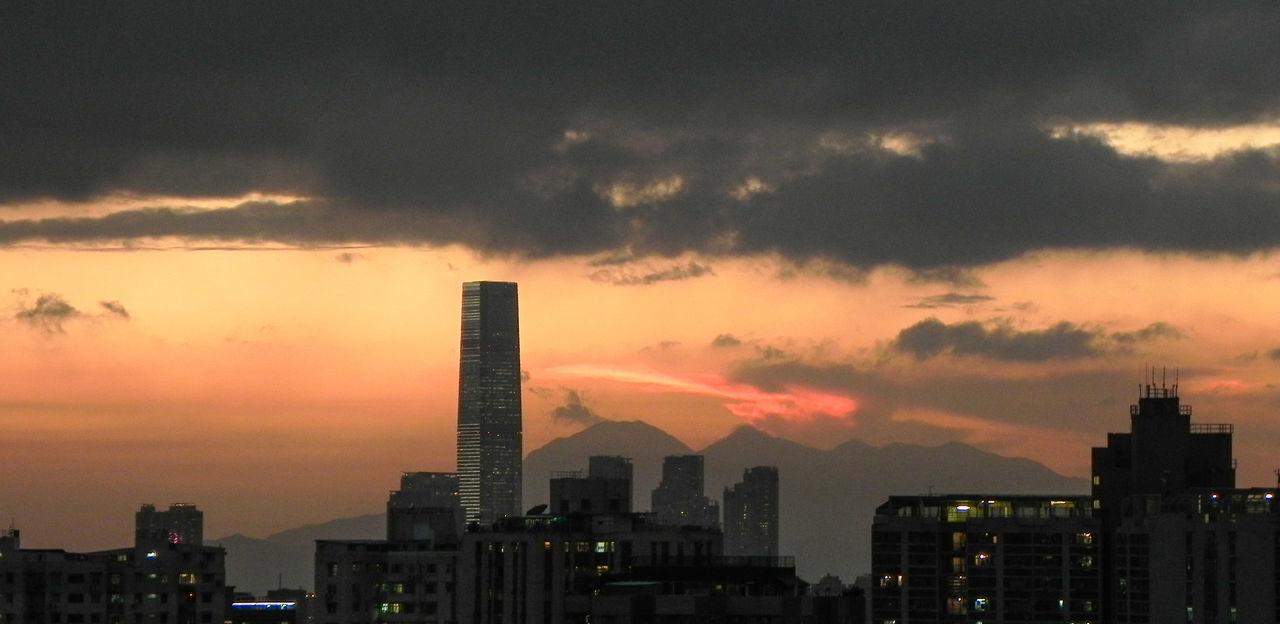 sunset, architecture, skyscraper, building exterior, city, built structure, cityscape, sky, modern, cloud - sky, no people, travel destinations, silhouette, urban skyline, outdoors, illuminated, nature