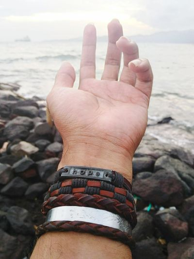 Human Hand Human Body Part Beach Sea Outdoors Close-up EyeEm Water Sunset Nature CARALOKAL123 Landscape Sky EyeEm Best Shots ToTravelIsToLearn EyeEm Indonesia Travel Eyeemweekly Bali Horizon Over Water Sunset_collection EyeEm Gallery EyeEm Vision Colors Of Life Hope TCPM