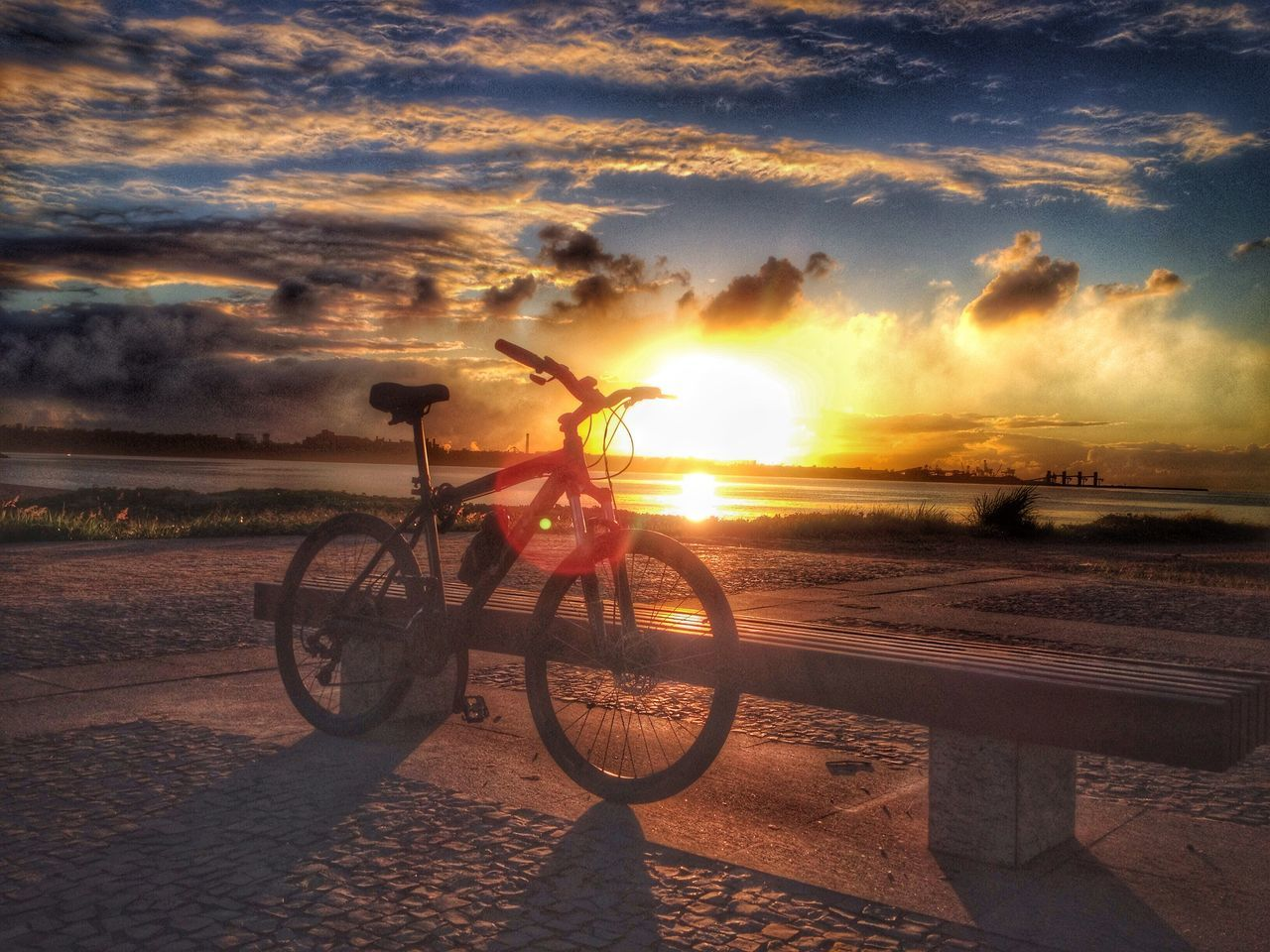 sunset, sky, cloud - sky, nature, beach, sea, outdoors, bicycle, sun, silhouette, sunlight, transportation, beauty in nature, sand, land vehicle, water, scenics, real people, one person, day, people