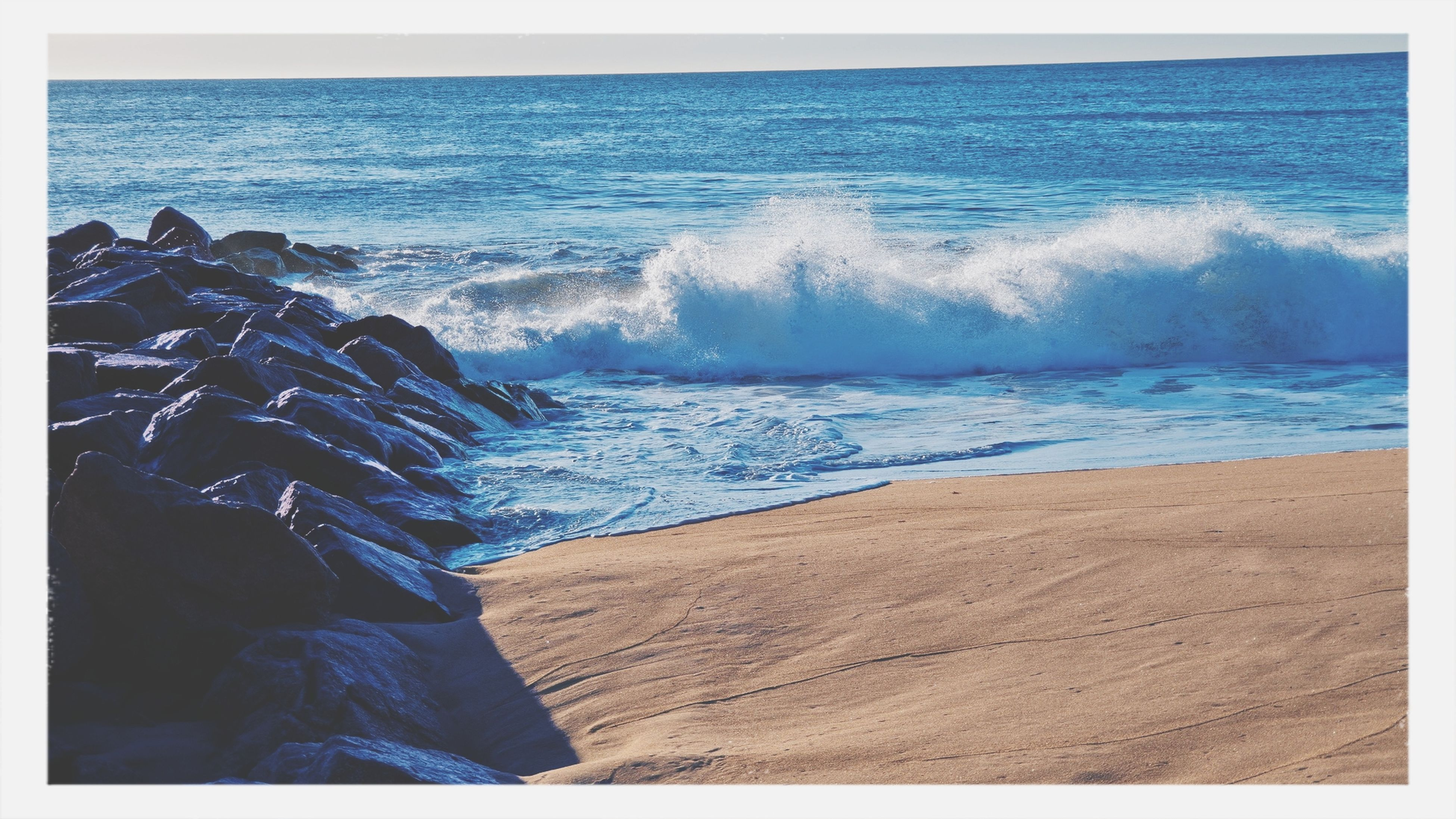 sea, transfer print, water, horizon over water, beach, auto post production filter, wave, scenics, beauty in nature, surf, shore, nature, tranquility, tranquil scene, sand, idyllic, blue, coastline, day, outdoors