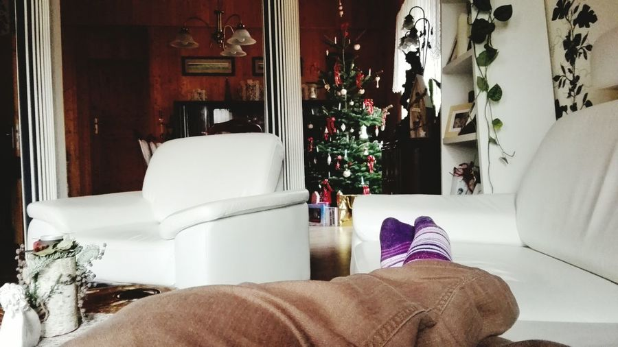 Winter Indoors  Cold Temperature Home Interior Christmas Human Body Part Low Section Relaxing From My Point Of View December2016 Christmas Is Here  Christmas Around The World Christmastime Christmas 2016 Winter 2016 Bokeh Indoors  Christmas Lights Christmas Tree Christmas Decoration Christmas