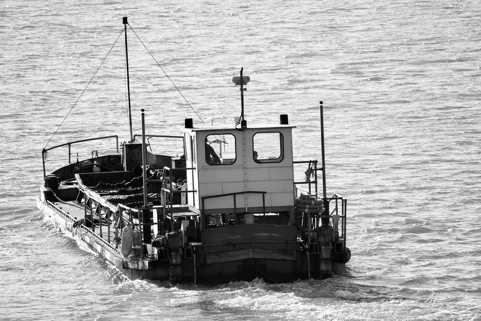 Dredging bardge at work Water Sea Mode Of Transport Waterfront Nautical Vessel Day Nature Wave Tranquility River Blackandwhite
