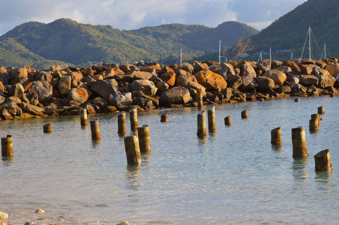 Beachphotography Day Foreground Focus Mountain Range No People Non-urban Scene Rocks And Water Sea And Sky Tranquil Scene Water Wood In Water Wooden Wooden Post