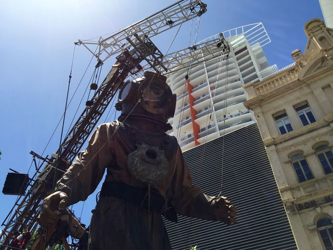 PERTH, AUSTRALIA-FEBRUARY 14, 2015: Journey of the Giants, Giant Marionette Diver and cityscape, public International Arts Festival Art Art Event Australia Australianshepherd Belts And Pulleys City Cityscape Crane Crowds Culture Diver Festival Giant Human International Journey Marionette People Puppeteers Walking Winchester Wooden
