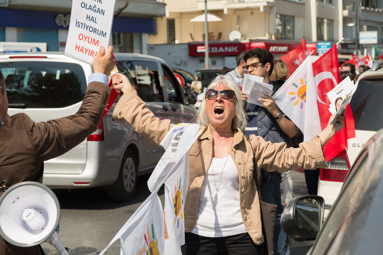 Protestors during a rally against the recent referendum in Turkey Anti Bebek Crow Flag Flags Istanbul No People Outdoors People Protest Rally Real People Referendum Sign Standing The Photojournalist - 2017 EyeEm Awards Women