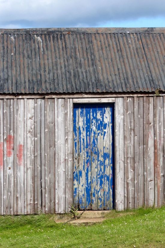 Fading paint on wooden shed Weathered Wood - Material Damaged Abandoned EyeEmNewHere Scotland Architecture Day No People Outdoors Barn Sky Building Exterior Rustic Close-up Pealing Paint Faded Shed Blue Door