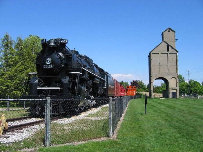 Just Resting Architecture Black Engine Blue Built Structure Day Elevator Green Color Outdoors Railroad Engine Sky