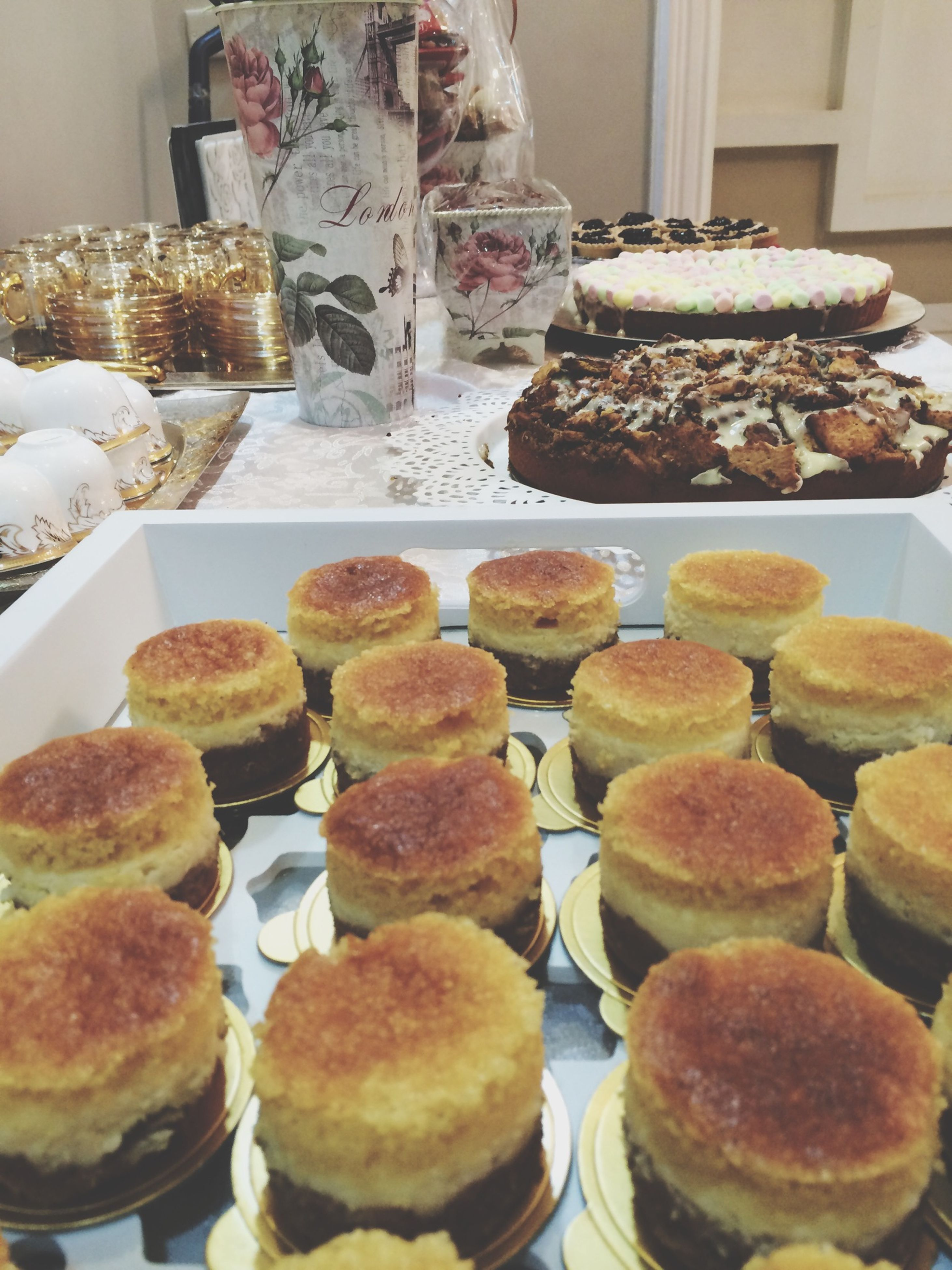 food and drink, indoors, food, sweet food, freshness, ready-to-eat, still life, dessert, unhealthy eating, indulgence, variation, arrangement, choice, abundance, in a row, cake, plate, temptation, table, large group of objects