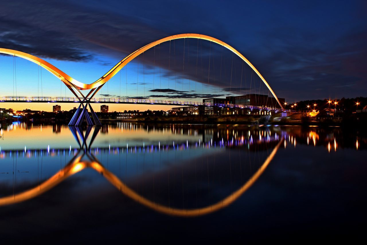 Architecture Bridge - Man Made Structure Building Exterior Built Structure City Cloud - Sky Connection Day Illuminated Infinity Bridge Nature No People Outdoors Reflection River Sky Sunset Water