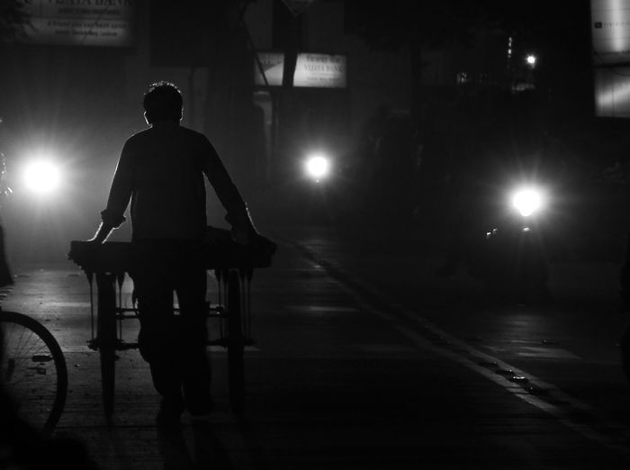 #indianstreets #Black&White #blackandwhite #carlights #photography #Shadow #silhuette #streetlife #streetphotography City Life Lens Flare Lifestyles Night Outdoors First Eyeem Photo