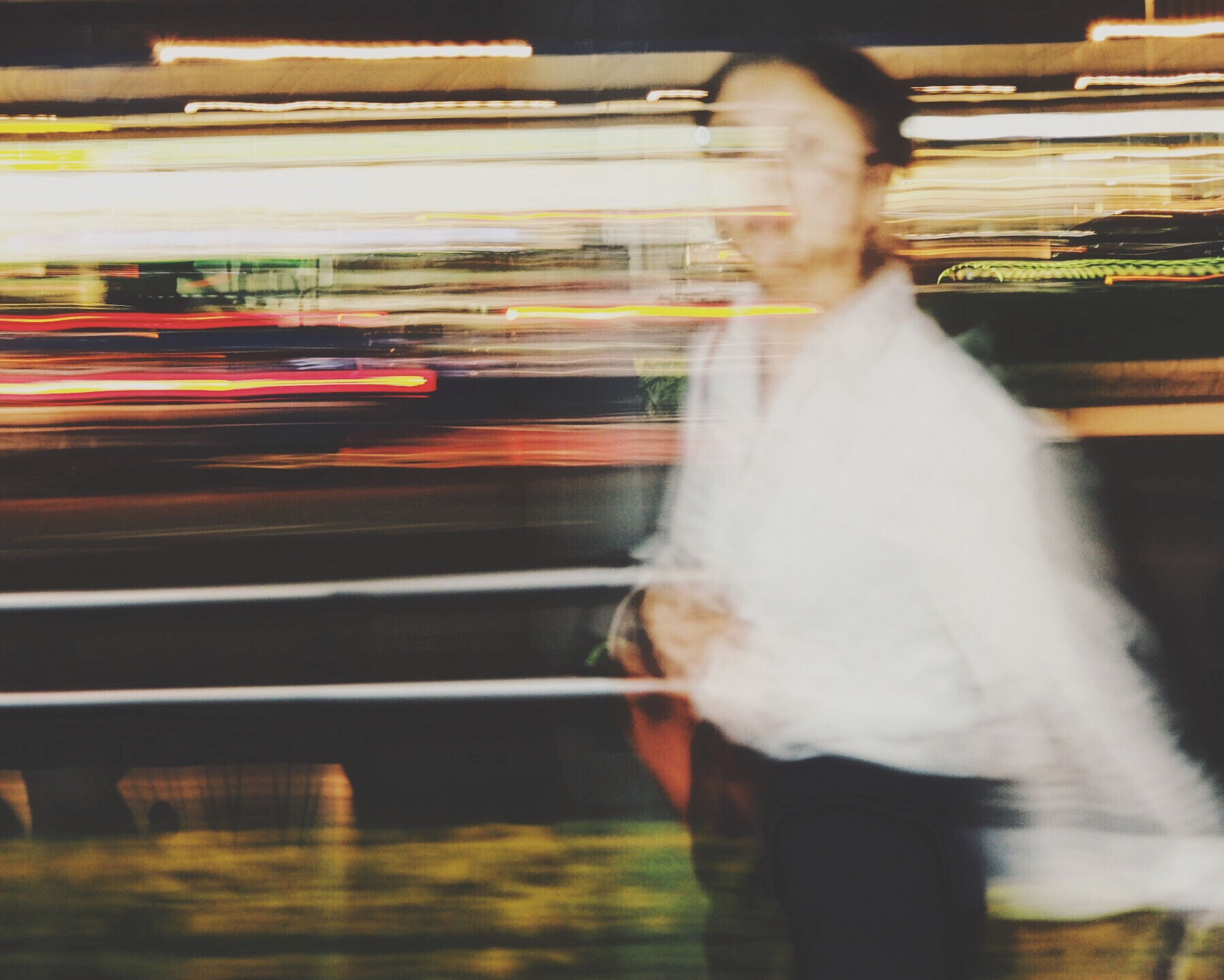 blurred motion, motion, speed, long exposure, transportation, real people, walking, one person, public transportation, rear view, indoors, day, people