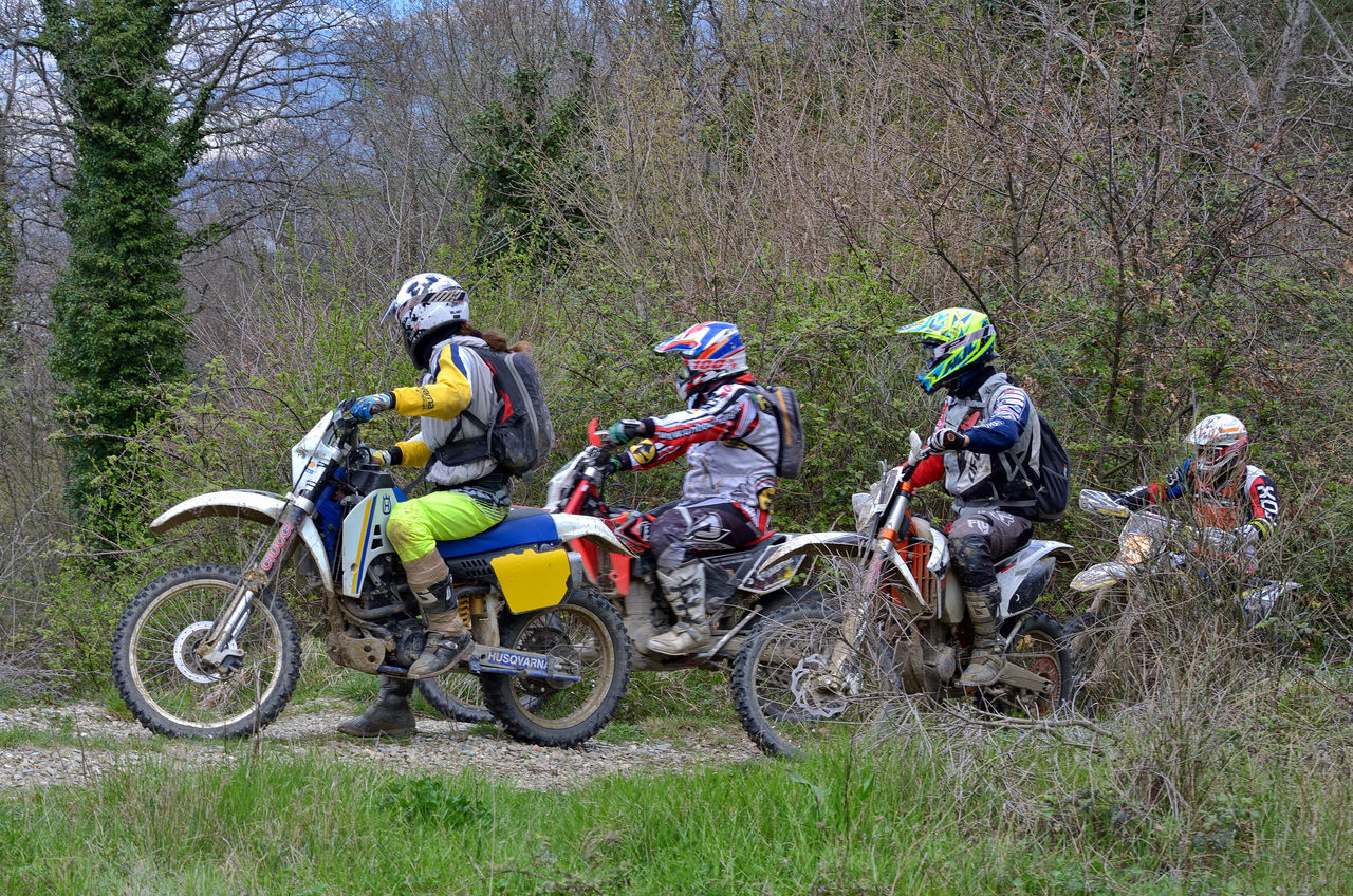 Adult Adults Only Adventure Challenge Competition Crash Helmet Day Extreme Sports Forest Full Length Men Motocross Motorcycle Motorcycle Racing Motorsport Only Men Outdoors People Real People Skill  Sport Sports Race Sports Track Young Adult