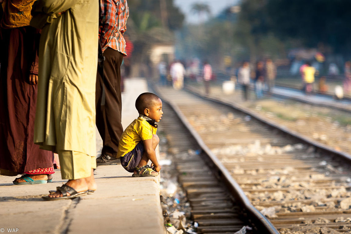 The little one dives deep into the realm of his thoughts! Outdoors Kids Railroad Station Rail Platform Jessore, Bangladesh