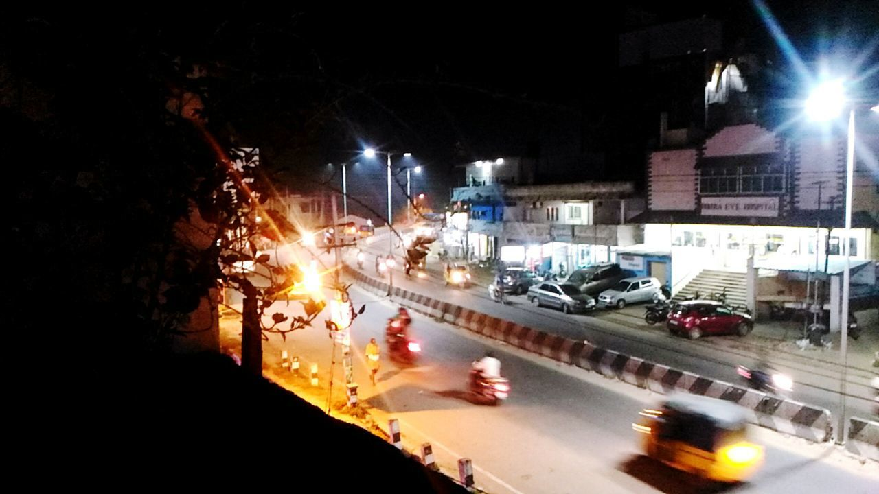 illuminated, night, car, transportation, land vehicle, road, street, mode of transport, city, outdoors, built structure, building exterior, architecture, no people