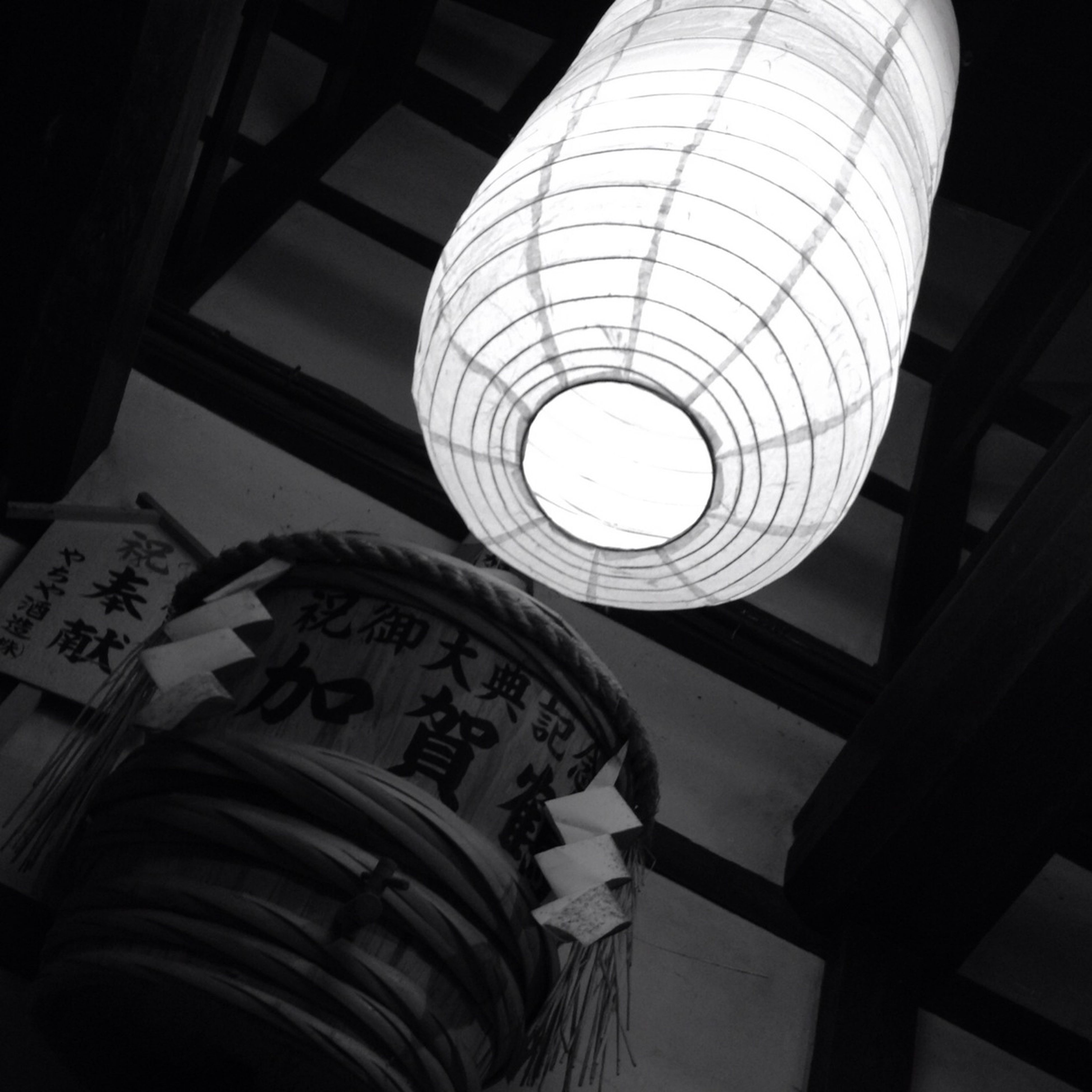low angle view, indoors, illuminated, architecture, lighting equipment, built structure, ceiling, modern, electric lamp, electric light, electricity, no people, hanging, design, building exterior, pattern, directly below, building, technology, communication