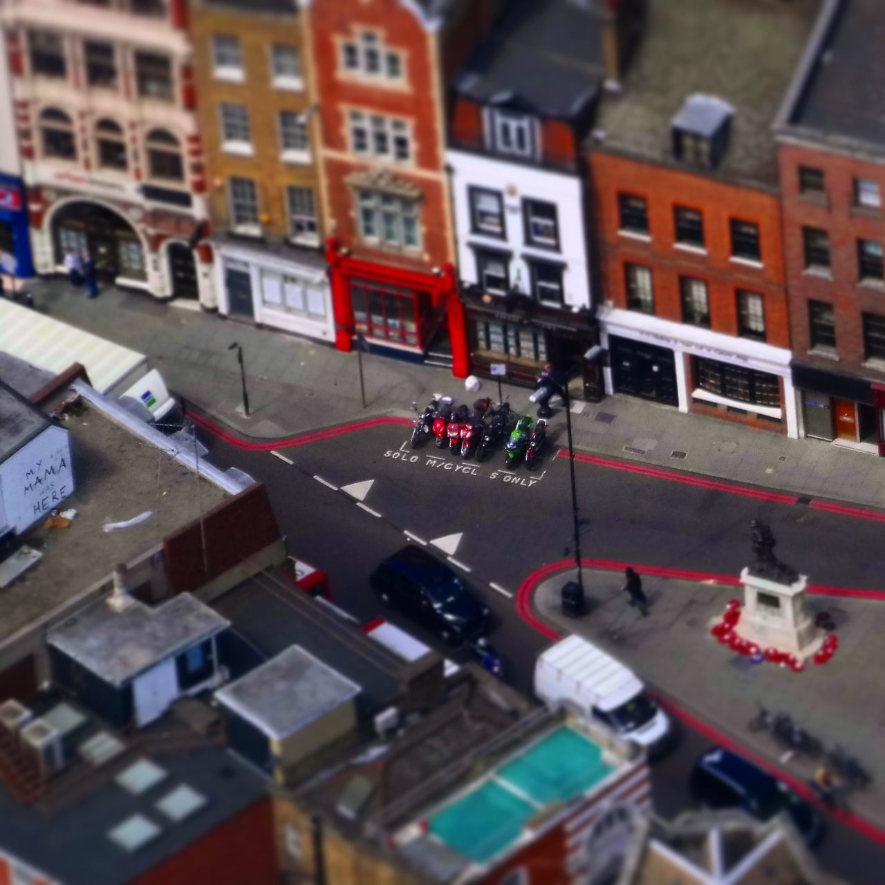 architecture, city, building exterior, built structure, transportation, street, high angle view, land vehicle, large group of people, day, outdoors, red, road, men, tilt-shift, people