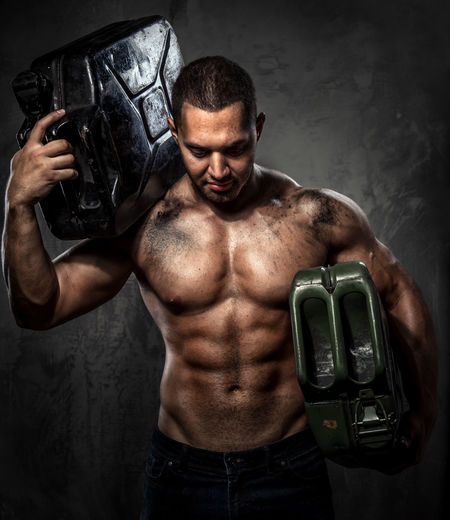 Muscular man with metal fuel can Athletic Benzine Container Fuel Gas Gasoline Man Power Can Canister Energy Flammable Fuel Can Fuelling Jerry Jerrycan Men Muscular Muscular Build Muscular Man Oil Petrol Strength Strong Tank