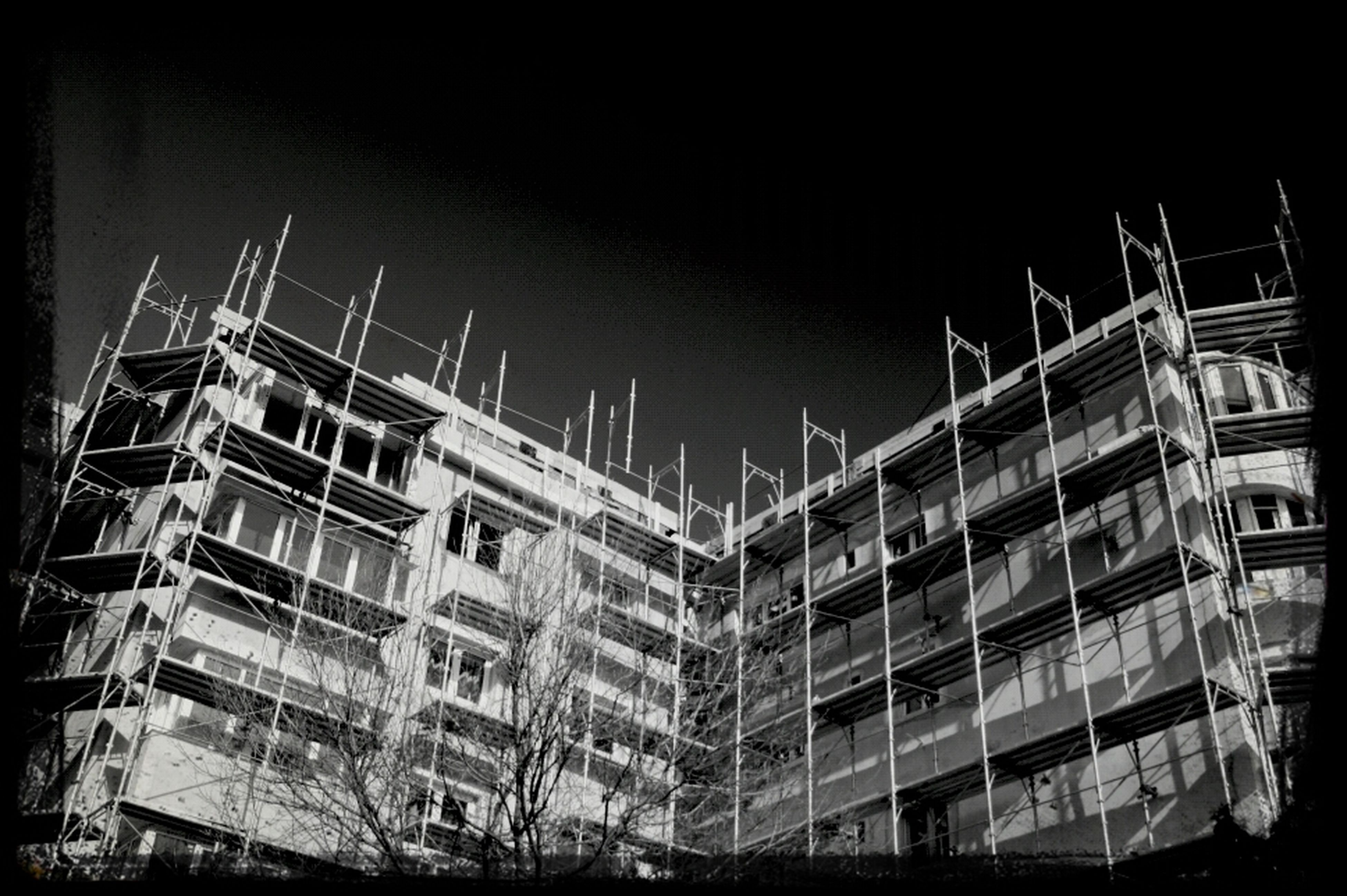 transfer print, building exterior, architecture, built structure, auto post production filter, clear sky, city, low angle view, building, residential building, residential structure, development, outdoors, no people, window, vignette, night, sky, construction site