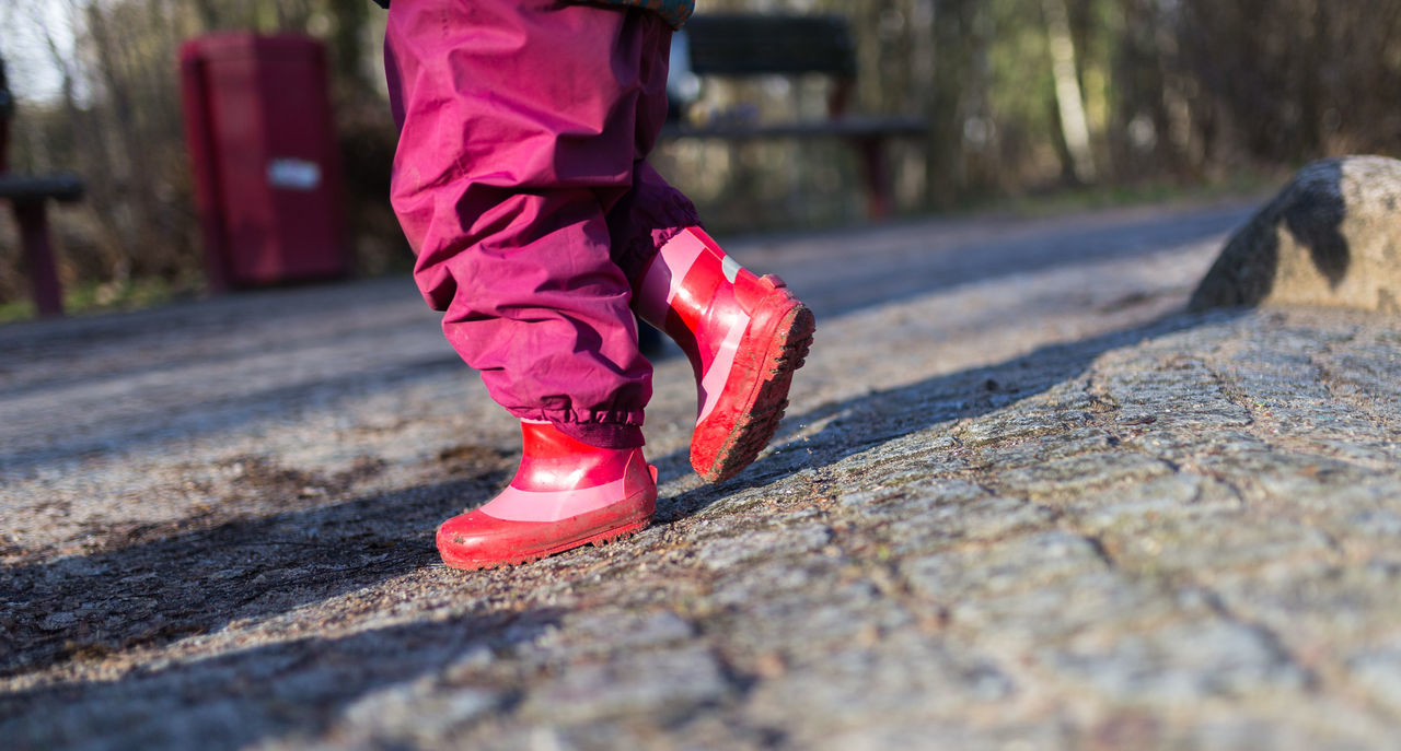 walking in rubber boots Canon Child Childhood Close-up Human Body Part Motion One Girl Only One Person Outdoors People Rubber Boots Shadows Sun