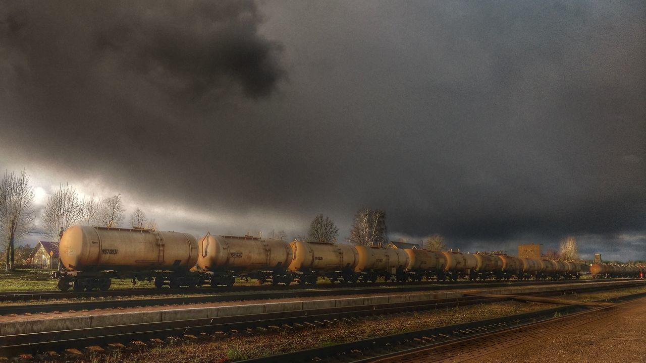 transportation, rail transportation, sky, cloud - sky, no people, train - vehicle, railroad track, outdoors, freight transportation, day, nature