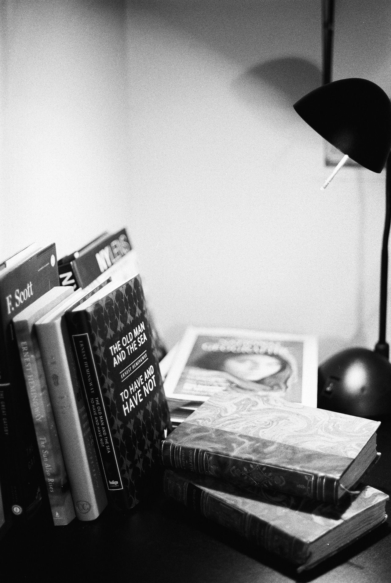 My numerous lectures before bed. National Geographic, Ernest Hemingway, Francis S. Fitzgerald, Victor Hugo... What about you? What is on your bed stand? Thunder Bay, Northern Ontario American Literature Analog Art Black And White Blackandwhite Books Books ♥ Close-up Contrast Film Photography History Ilford Ilford Film Indoors  Light Literature Magazine Night Night Stand No People Reading Reading & Relaxing Reading A Book Reading Time Shadows