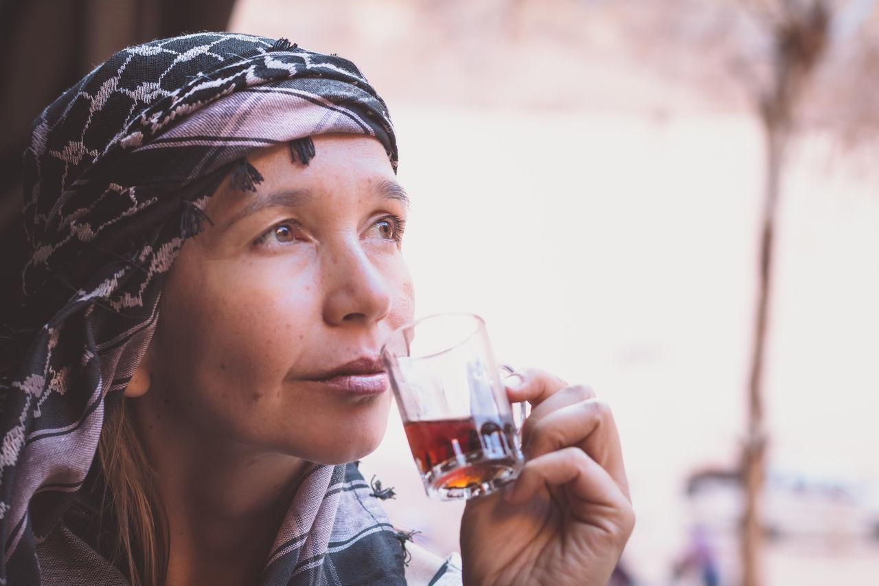 Thoughtful Woman Having Tea