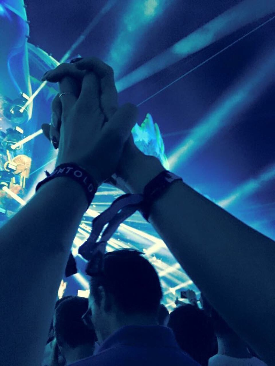 human body part, human hand, arts culture and entertainment, human arm, event, performance, dancing, music, people, performing arts event, nightlife, crowd, close-up, adult, night, indoors, adults only, popular music concert, young adult