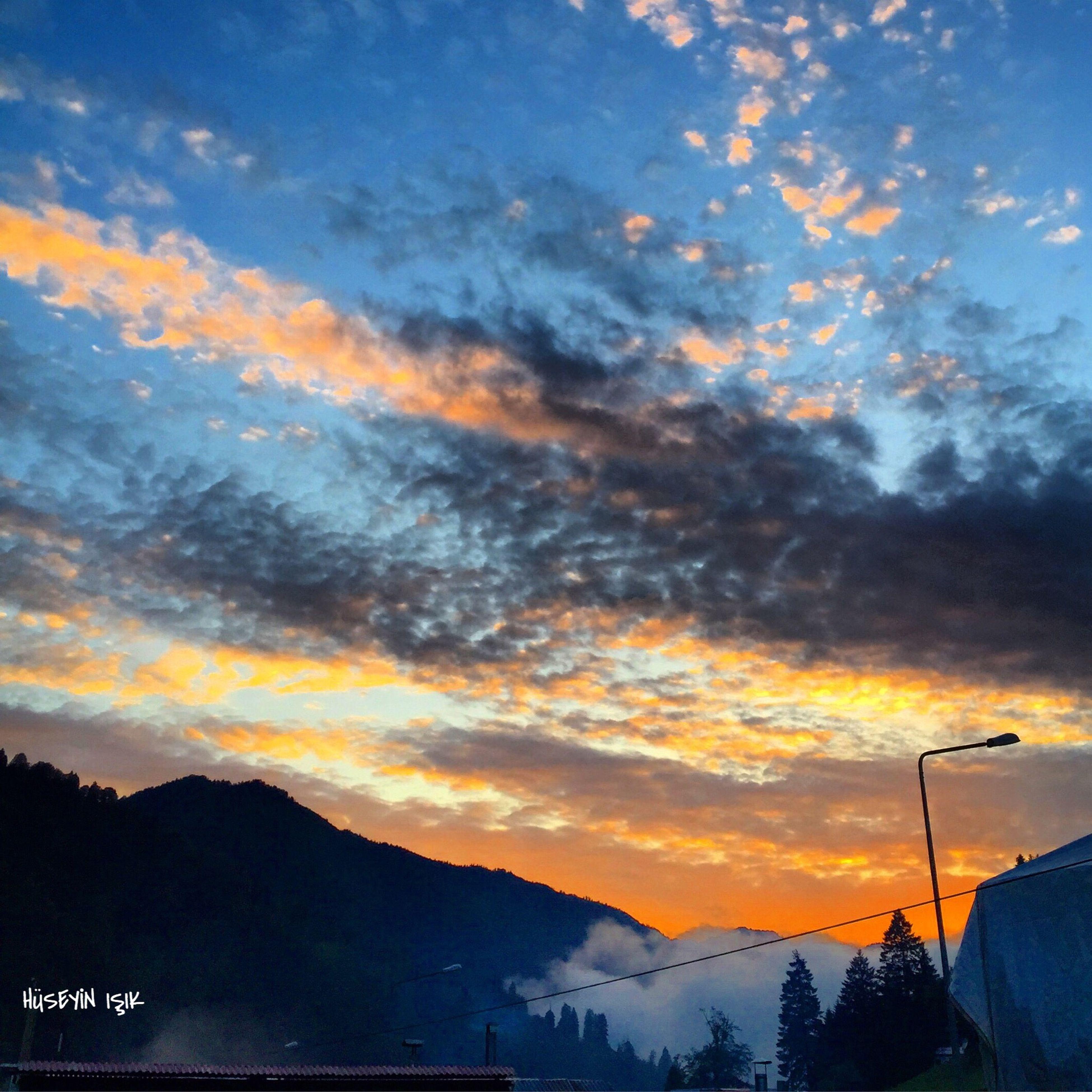 sunset, sky, scenics, beauty in nature, tranquil scene, mountain, tranquility, cloud - sky, silhouette, orange color, nature, landscape, cloud, idyllic, dramatic sky, mountain range, cloudy, non-urban scene, weather, dusk