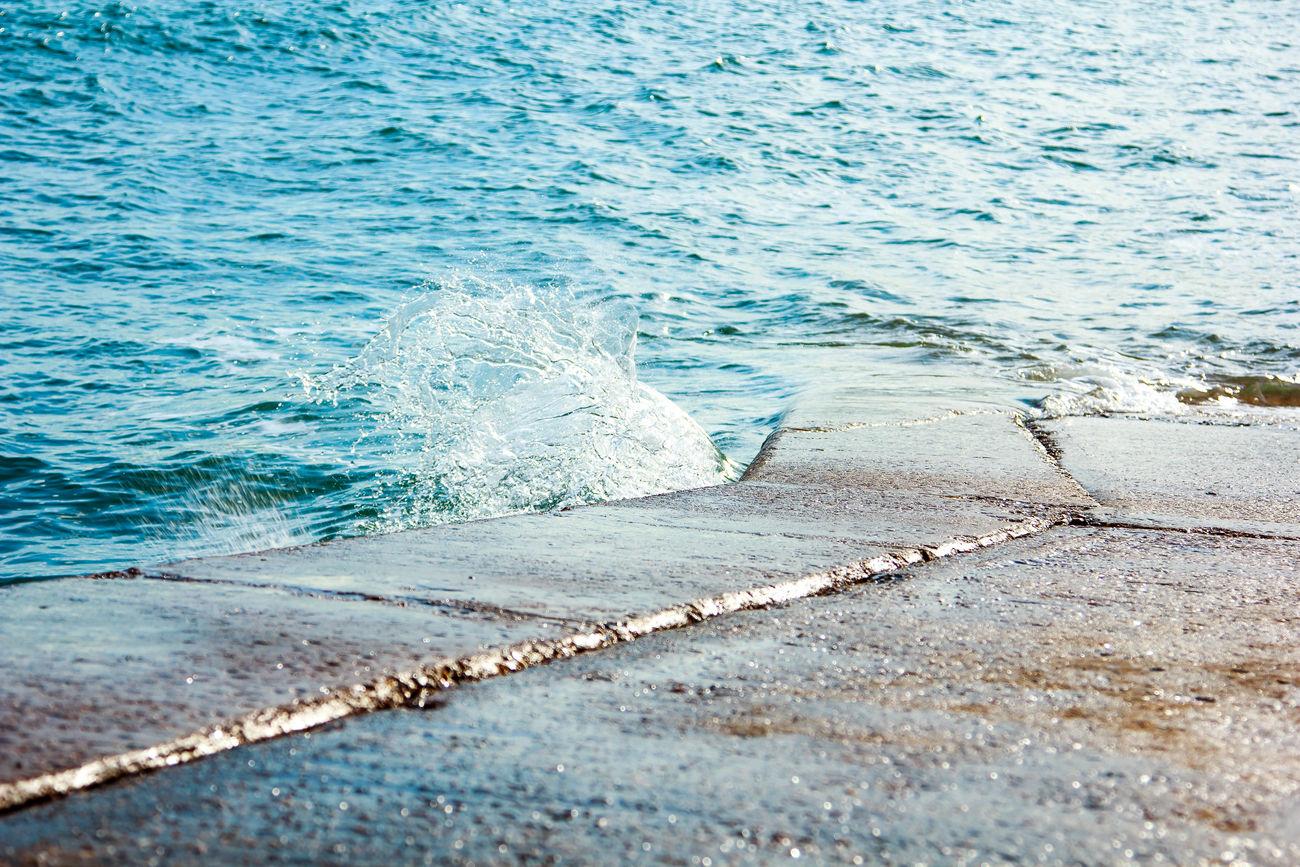 Water breaking on the slipway. Beach Beauty In Nature Coast Coastline Day Lapping Water Nature No People Outdoors Sand Scenics Sea Slipway Slipways To Sea Solent Splashing Droplet Splashing Water Splashing Water On The Rocks! Tranquility Water Wave