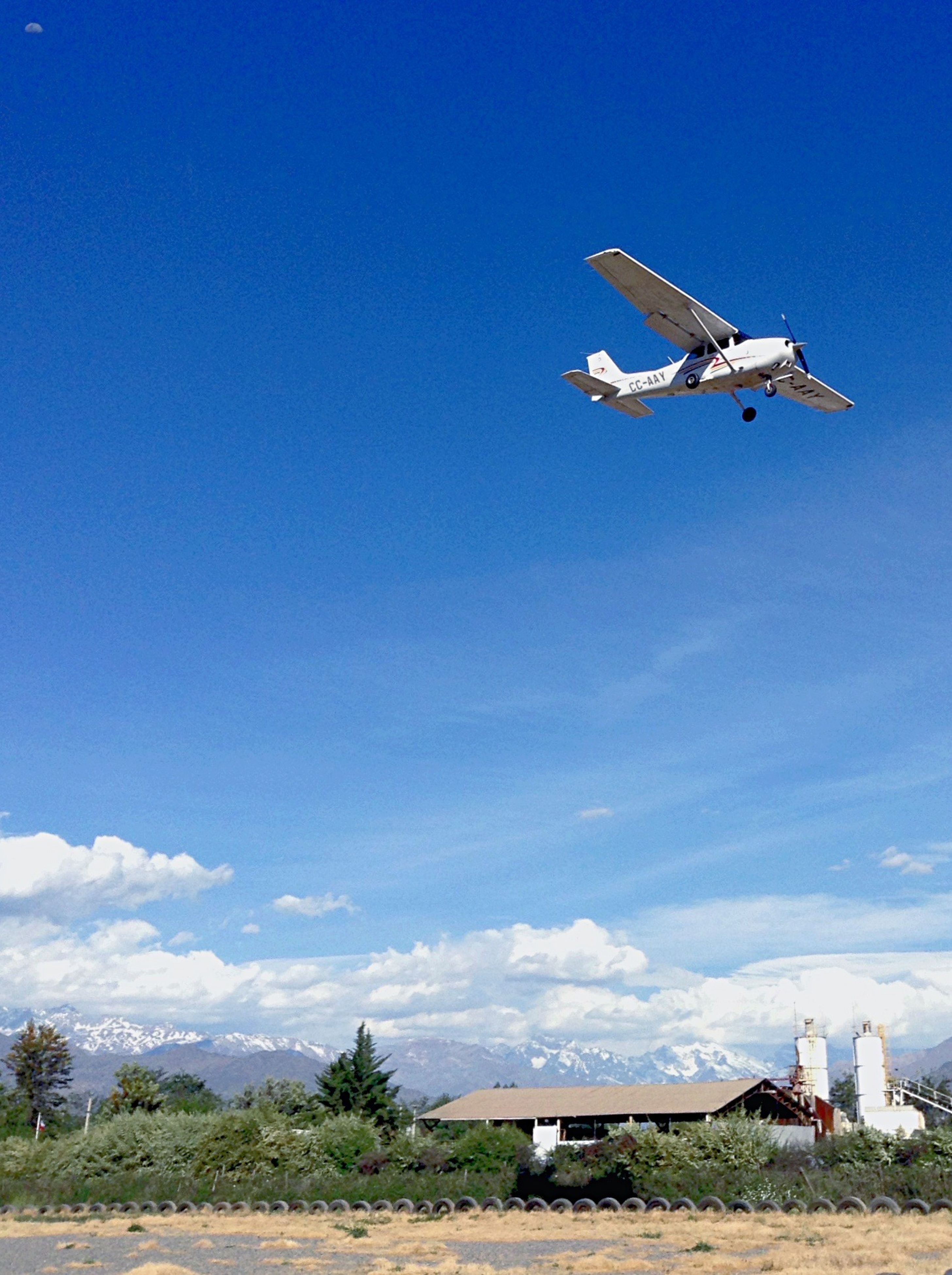flying, blue, sky, landscape, transportation, outdoors, tranquil scene, nature, non-urban scene, tranquility, scenics, cloud - sky, day, beauty in nature