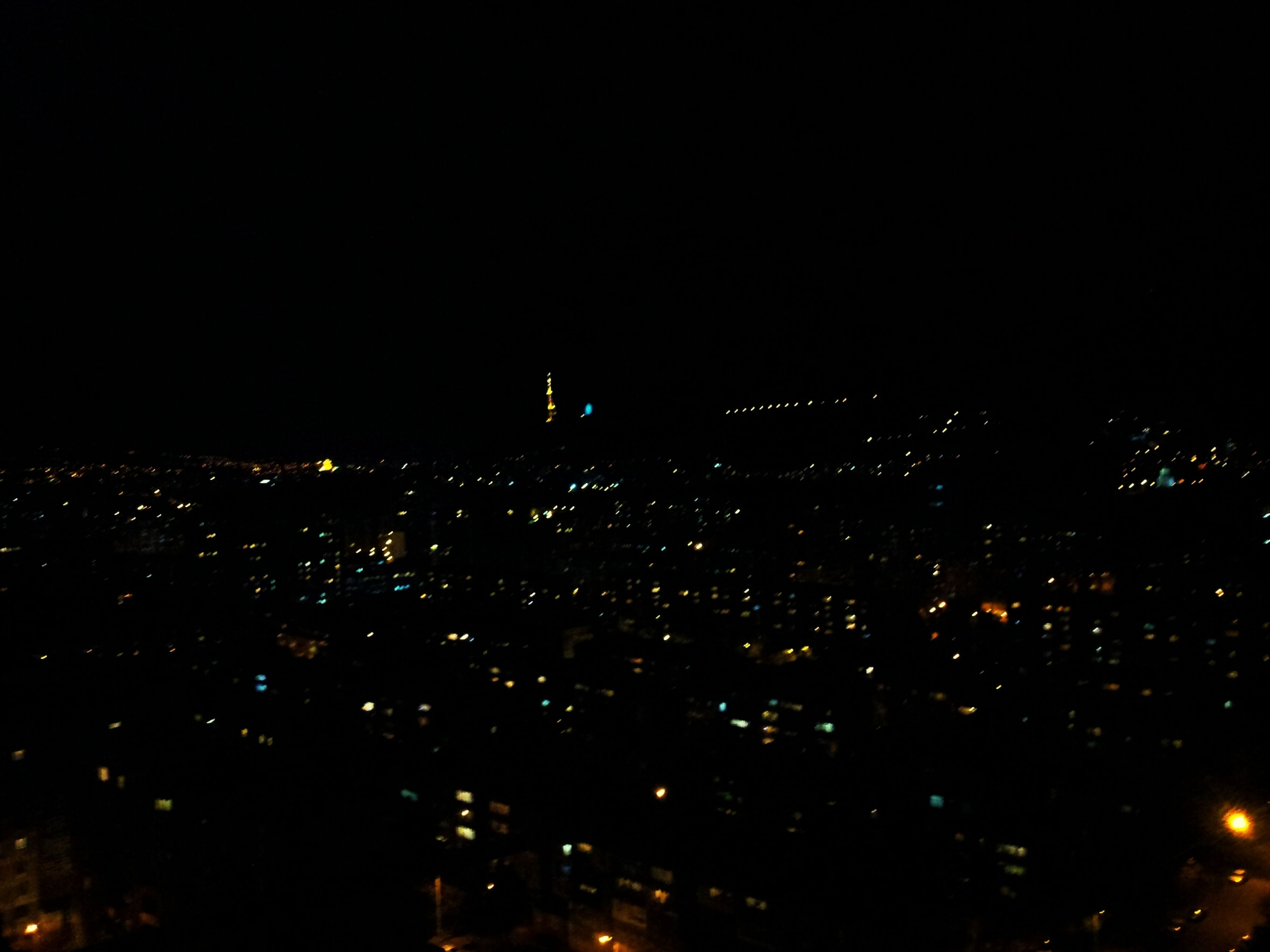 night, illuminated, city, cityscape, building exterior, dark, architecture, copy space, built structure, clear sky, crowded, sky, high angle view, light, glowing, no people, light - natural phenomenon, outdoors, city life, aerial view